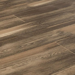 Lamton - Lamton Laminate - 12mm Legenda Collection - [19.0 sq ft/box] - Legenda Charcoal -    Laminate flooring represented here in the Cypress Collection is a reminder of how easy and inexpensive it is to get that high-end look of real wood flooring while staying within budget. All the rich color variations of real wood and even the finely detailed texturing on each board are here, thanks to state of the art manufacturing techniques. And every board is designed to last, and to feel and sound like a real wood board underfoot.    It's also easy to get a floor covering that you can count on to look great, and perform well in a wide range of design contexts where solid wood floors aren't really an option. This means basement areas, and interiors over concrete slabs can be transformed easily with the universally appealing look of wood grains and colors.    Wood flooring effects with laminate versatility    To help you gain that warm and organic wood flooring look more easily and efficiently, each four-sided beveled edge board is equipped with a glueless Instalock (Unilin) locking system that is DIY-friendly, and allows for less mess, too. Whether you're looking to transform a residential space, or add a touch of style to a light commercial space, options from The Cypress Collection provides a decorative, reliable, abrasion resistant flooring surface that is designed to last.     And the best part is that most will simply not be able to distinguish this robust laminate flooring for the real thing. This is high-end, wide-board style at a price that makes those effects easily gained within a modest budget. And because these are laminate floors, you can get that effect more easily, and more quickly too.    12mm laminate flooring at incredible prices    This collection of sturdy laminate flooring is the product of innovation and supreme attention to detail at the manufacturing stages. We at BuildDirect work closely with manufacturing partners on bring these options for