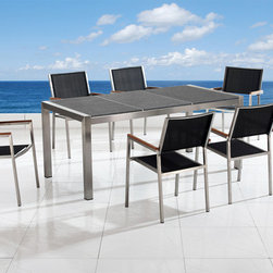 Outdoor Furniture - Modern outdoor dining table with black granite top on stainless steel frame by Beliani