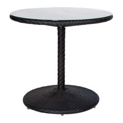 Whitecraft by Woodard Barlow Round Patio Bistro Table - Meet the environmentally friendly and impeccably serviceable Whitecraft by Woodard Bali Round Patio Bistro Table. The metal frame is powder-coated aluminum for spectacular durability. A sweet band of herringbone Patterned wicker around the table's rim creates a touch of textural interest. You choose the finish color from available options. Woven of UV-protected, rot-resistant high density polyethylene (HDPE), so you can rule out fading, cracks, chips, and peeling. Heat won't cause deformation. Kind of like the postal service, moisture, freezing temperatures, and salt spray won't stop this table from doing its duty in style. The glass top provides a perfectly smooth resting place for mimosas, morning coffee, and more. Whitecraft has been proud to produce quality furnishings in South Carolina for over 140 years.Woodard: Hand-crafted to Withstand the Test of TimeFor over 140 years, Woodard craftsmen have designed and manufactured products loyal to the timeless art of quality furniture construction. Using the age-old art of hand-forming and the latest in high-tech manufacturing, Woodard remains committed to creating products that will provide years of enjoyment.Superior Materials for Lasting DurabilityAll Seasons Outdoor Wicker is the latest addition to the Woodard line of quality furniture. Each piece is constructed using cutting-edge synthetic fibers, hand-woven over an aluminum frame. With this combination of resilient, weather-resistant materials and Woodard's quality workmanship, All Seasons Wicker will retain its beauty and integrity for years.Most Woodard furniture is assembled by experienced professionals before being shipped. That means you can enjoy your furniture immediately and with confidence.Together, these elements set Woodard furniture apart from all others. When you purchase Woodard, you purchase a history of quality and excellence, and furniture that will last well into the future.Important NoticeThis item is custom-made to order, which means production begins immediately upon receipt of each order. Because of this, cancellations must be made via telephone to 1-800-351-5699 within 24 hours of order placement. Emails are not currently acceptable forms of cancellation. Thank you for your consideration in this matter.