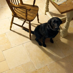 Limestone Floor Tiles - This limestone floor is set in a French Pattern. Just about any tile can be installed like this, but natural limestone really shines when it's used like this.