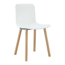 LexMod - Sprung Dining Side Chair in White - Deliver a passion for style within the fold of some sleek minimalist lines. Sprung is a simple, happy dining chair that brings you the unexpected. From its clever unrefined wooden dowel legs, to its molded hard plastic seat, Sprung adds a delightful element to your dining area.