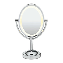 "Conair - Conair Double-Sided Lighted Oval Mirror, Polished Chrome - Consider yourself the ""fairest of them all"" with this lighted mirror. It won't matter if you steam up your bathroom, because this shiny, polished chrome piece is fog-resistant. One side displays a regular view, the reverse is seven times magnified, making it the very definition of mirror, MIRROR. Go ahead, admire yourself."
