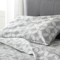 """Cate Blue Twin Sheet Set - Taking note of the stunning textiles of India's Rajasthan region, the Cate collection recreates the artisanal play of organic and geometric forms in vibrant color. Versatile look in soft, cotton percale mixes and matches for a varied, layered bed. Generous 16 """" pockets accommodate thicker mattresses. Bed pillows also available."""