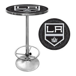 Trademark Global - Round Pub Table w NHL Los Angeles Kings Logo - Bring color and an athletic style to your game room or bar area decor with this stylish pub table, a perfect way to show your support for your favorite hockey team. The table has a wood top with the Los Angeles Kings logo protected by a clear acrylic shield and a chrome colored steel base. Great for gifts and recreation decor. 0.125 in. Scratch resistant UV protective acrylic top. Full color printed logo is protected by the acrylic top. Table top is trimmed with chrome plated banding. 1 in. Thick solid wood table top. Chrome base with foot rest and adjustable levelers. 28 in. L x 28 in. W x 42 in. H (72 lbs.)This National Hockey League officially licensed pub table is the perfect for your game room on Hockey Night.