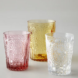 """Horchow - Six Fleur-de-Lis Juice Glasses - Handcrafted glassware in Amber, Pink, or Clear. Select color when ordering. Dishwasher safe. Highballs, 4""""T; hold 7.4 ounces. Juice glasses, 3.5""""T; hold 5.7 ounces. Made in Portugal."""