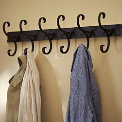 "Vintage Scroll Row of Hooks - Keep the entryway organized with this handsome row of double hooks. Sturdy iron is carefully sculpted into sweeping scrolls, then finished to echo the look of vintage blacksmith tools. 32"" wide x 5.5"" deep x 8.5"" high Crafted of iron with a blacksmith finish. Six oversized double hooks organize coats, bags and scarves. Includes mounting hardware. Catalog / Internet only."