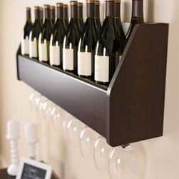 "Prepac - Floating Wine Rack in Espresso - Finished in durable rich espresso laminate . Mounts easily to wall with our innovative hanging rail system. Shelf holds up to 18 standard 750ml wine bottles or a variety of liquor bottles  (65lbs total weight capacity)  . Rack holds approximately 8-12 stemmed glasses. Constructed from CARB-compliant, laminated composite woods . Includes a 5-year manufacturer's limited parts warranty. 40.75 in. W x 7.25 in. D x 12.75 in. H Display your finest bottles of wine and liquor with this clever Floating Wine Rack. This wall mounted rack has a compact design to conserve space in your bar, living room, kitchen or dining area. With its sturdy construction you can display up to 18 standard 750 ml bottles of wine or spirits. Keep a variety of stemmed glasses at hand by sliding them into the hidden channel underneath. This product ships ""Ready to Assemble"" with an instruction booklet for easy assembly. Installation is easy with Prepac's hanging rail system."