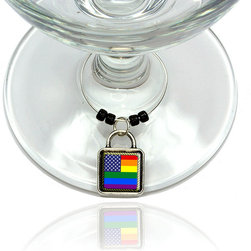 "Made on Terra - Flag of USA Rainbow Wine Glass Silver Charm - Your guests have arrived and the atmosphere is electric. A sip of wine here, a sip of a cocktail there and you find the conversation turning to the charming baubles you've placed on the glasses, something special you chose for each of your eclectic guests. They love them and appreciate your thoughtfulness. You love them for their uniqueness and that no one forgets which glass they were using.  Choose from Made on Terra's many designs for the best party ever. Ring is 1"" diameter; measures 2"" from top of ring to bottom of charm. Made of metal and plastic. Sold individually."