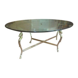Pre-owned Seahorse Coffee Table - This glamorous coffee table is stylized with seahorse legs in a gold/brass tone finish and features a heavy oval glass top. This table will look fabulous styled with a tray, books, and flowers! Its clear glass top gives you a great opportunity to showcase a great rug, as well!