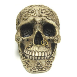 Celtic Lion Knotwork Human Skull Statue Bone Finish - This wickedly awesome human skull figure / statue is covered in symmetrical Celtic knotwork patterns, as well as other Celtic designs, such as lions, snakes and crosses. Made of cold cast resin, the figure stands 5 inches tall, is 7 inches deep, and 4 1/2 inches wide. One of the most elaborately carved skulls we carry (it even has a golden nose piercing), it makes a great Halloween decoration, and is a great gift for any skull lover.