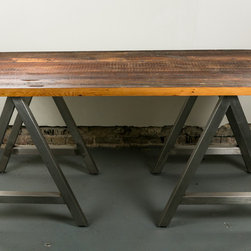 Reclaimed Sawhorse Desk - Welded steel sawhorses with a reclaimed old growth top are the perfect combination for this clean and modern yet rustic work area. The saw horses are welded and polished to perfection. The solid 2 inch thick minimally planed top shows the markings of it's previous life.