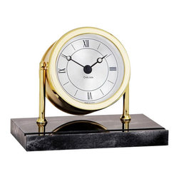 """Chelsea Chatham Clock in Brass on Black Marble Base - The Chatham makes a dramatic statement, combining the brilliance of highly-polished, forged brass with the strong, sleek look of black marble. This attractive piece features a swivel-style case, richly silvered dial, German quartz movement and a matching engraving plate. The dial measures 3"""". The overall dimensions are: 5""""H x 7""""W. This clock weighs 8 lbs and comes with a two year warranty. Our price includes engraving  gift card."""