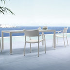 Papaya Collection Wicker Outdoor Dining Table and Chairs - The Papaya Collection features an a glass top dining table and chairs both made of outdoor wicker.