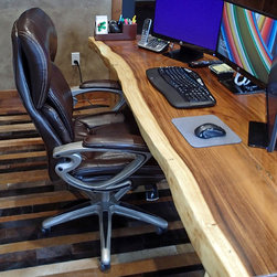 """Custom Natural Edge Desk With Unique Steel Trestle - A beautiful, natural edge monkeypod wood desk is the centerpiece of this home office in Wisconsin.  This desk measures 6'-7"""" wide (2 meters) x approximately 34"""" deep x 3"""" thick.  The steel trestle is custom by Impact Imports.  If you are interested in a natural edge desk or dining table and have a creative idea for a steel trestle, we can make it at our steel shop!"""