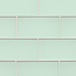 """Spa Glass - Crete 3x6 Subway Glass Tile BOX - This stunning Crete Glass Subway Tile has a unique gray taupe backing reflecting through the natural hue of glass. Perfect for brightening any space, this is the ideal tile for a backsplash, kitchen tile or bathroom tile. The tiles are individual (not mesh mounted) which allows the designer to create any configuration like traditional subway, stacked horizontal, vertical, herringbone or even create your own blend of colors. These are a very high grade glass subway tile with a baked polypropolene backing reflecting the color back thru a very clear glass. The tiles are kilned at very high temperature to make these rated as a """"Pool Tile"""" which makes the glass very durable and ideal for shower walls, wet areas and back splashes. Each piece is 3X6 and softly beveled. There are 8 pieces per square foot and the square foot price is $15.00. They come in boxes of 4 square feet or 32 pieces.The Price listed is for a single CARTON OF 4 SQUARE FEET."""