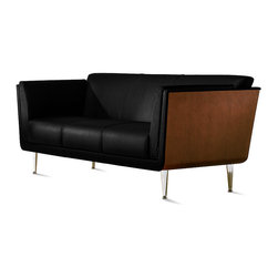Herman Miller - Goetz Sofa - This clean, contemporary sofa will turn you inside out. Designed by Mark Goetz, it breaks tradition by using a molded wood veneer shell to create its structural frame, rather than wrapping that frame in upholstery. The result is a truly luxurious sofa that invites you to lounge just a little longer, either seated or stretched out to take a midday snooze.