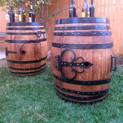 Wine Barrel Products - Wine barrel furniture with custom, hand crafted ironwork.  All products can be customized to fit a variety of purposes from high end wine racks to simple beds for your furry friends.  Please contact me for more information and ask me about custom work.