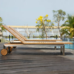 Siro Teak and Stainless Steel Chaise Lounge Chair - Lounge in comfort and modern style with the Siro Chaise Lounge Chair, made from solid stainless steel and natural teak wood. Two rear wheels allow you to easily move this contemporary lounger to your perfect place under the sun.
