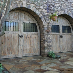 French Garage Doors - Attracted by is vibrant scenery, the French countryside has been home to some of histories greatest artist. Chateaus are designed and built in the French country to withstand some of the worlds most relentless weather conditions. Our French country garage doors combine the finest traditional French architecture with materials that remain beautiful naturally weathered.