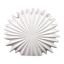 Urban Trends Collection - Ceramic White Seashell - Display this ceramic seashell in your bathroom, kitchen, or any space to add an aquatic ambiance. This figure is made of smooth ceramic and adorned sharp grooves to add texture to your home.
