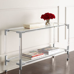 """Jonathan Adler - Jacques Lucite & Nickel Console - CLEAR/NICKEL - Jonathan AdlerJacques Lucite & Nickel ConsoleDetailsModern console.Lucite frame with brass hardware and brushed nickel details.Two tempered-glass shelves.50""""W x 16""""D x 28""""T.Imported.Boxed weight approximately 73 lbs. Please note that this item may require additional shipping charges.Designer About Jonathan Adler:Potter designer and author Jonathan Adler launched his first ceramics collection in 1994. His design philosophy: create a foundation of timelessly chic furniture and accessorize with abandon. With his roots still firmly in pottery he has expanded to become a complete lifestyle brand offering furniture lighting decorative objects fashion accessories and more. He is dedicated to bringing style craft and joy to life."""