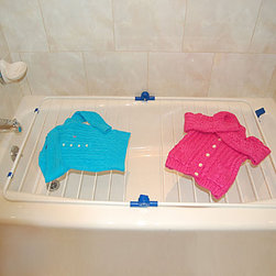 Improvements - Bathtub Drying Rack - With this clothes drying rack, water will drip from wet clothes right into the tub. Use a Bathtub Drying Rack to dry delicates and protect clothes from shrinkage. This clothes drying rack is also a great way to save energy and extend the life of your clothes. Collapsible Bathtub Drying Rack adjusts to any width to fit your bathtub. This space-saving clothes drying rack allows you to dry delicates, sweaters, towels and more -- right over the tub so water can easily drain away! Providing up to 32 feet of drying space, the Bathtub Drying Rack is designed of heavy-duty coated steel with sturdy plastic feet that hook to the edge of the tub. This versatile clothes drying rack can be used flat or standing, so you can either stretch out your garments for air-drying or hang items over the bars. When not needed, the Bathtub Drying Rack folds flat for storage. Benefits of the Bathtub Drying Rack:
