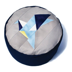 Origami Bluebird Patchwork Pouffe by Fun Makes Good Shop - This pouf is origami-inspired and handmade from leather and cotton. I love its geometric shapes. The great thing about a pouf is that it doesn't need much space. Plus, it can be used in so many ways: as a quick sidetable, as a place to lay your feet after a long day at the office and as an extra stool when you throw a party.