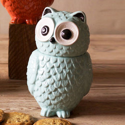 Owl Stash Jar in Blue - This colorful owl stash jar will liven up any kitchen décor with its wide-eyed look and textured, scalloped exterior replicating the look of feathers. Made of glazed ceramic, use it as a cookie jar in the kitchen or for storing tiny treasures, collectibles, candy, and more.