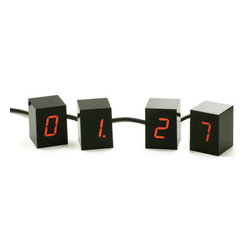 AREAWARE - Areaware Numbers LED Clock - Black/Red LED - An alarm clock consisting of four 2 inch tall cubes. Each cube displays one glowing LED digit to make up the time display. Unlike static boxes usually associated with alarm clocks, this interactive collection of changing numbers can be arranged in any configuration.