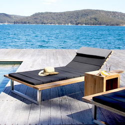Outdoor Furniture Collection - Woolamai single daybed in black outdoor fabric shown with Airlie low side table