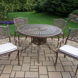 Oakland Living - 5-Pc Traditional Outdoor Dinning Set - Includes sunray table, four cushioned chairs and metal hardware. Lattice pattern and scroll work. Handcast. Hardened powder coat. Fade, chip and crack resistant. Warranty: One year limited. Made from rust free cast aluminum. Antique bronze finish. Minimal assembly required. Table: 48 in. Dia. x 29 in. H. Chair: 22.5 in. W x 22 in. D x 35 in. H (23 lbs.)The Oakland Mississippi collection combines grace style and modern designs giving you a rich addition to any outdoor setting. We recommend that the products be covered to protect them when not in use. To preserve the beauty and finish of the metal products, we recommend applying an epoxy clear coat once a year. However, because of the nature of iron it will eventually rust when exposed to the elements.