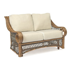 Woodard Belmar All Weather Wicker Gliding Loveseat - Just a few things are required to transform your backyard garden into the most romantic spot in the neighborhood: an abundance of flowers in bloom, a balmy evening, and the Woodard Belmar All Weather Wicker Gliding Loveseat. Crafted with durable weather-resistant resin wicker over a sturdy aluminum frame, this cozy loveseat is brimming with classic detail: a high back, sweeping curled arms, a delicate lattice weave, and a natural light brown finish. At the base, a smoothly gliding mechanism provides easy, gentle back-and-forth movement. Included with this seat for two are plump fabric cushions, available in an assortment of colors.Important NoticeThis item is custom-made to order, which means production begins immediately upon receipt of each order. Because of this, cancellations must be made via telephone to 1-800-351-5699 within 24 hours of order placement. Emails are not currently acceptable forms of cancellation. Thank you for your consideration in this matter.Woodard: Hand-crafted to Withstand the Test of TimeFor over 140 years, Woodard craftsmen have designed and manufactured products loyal to the timeless art of quality furniture construction. Using the age-old art of hand-forming and the latest in high-tech manufacturing, Woodard remains committed to creating products that will provide years of enjoyment.Superior Materials for Lasting DurabilityIn the Aluminum Collections, Woodard's trademark for excellence begins with a core of seamless, virgin aluminum: the heaviest, purest, and strongest available. The wall thickness of Woodard frames surpasses the industry's most rigid standards. Cast aluminum furniture is constructed using only the highest grade aluminum ingots, which are the purest and most resilient aluminum alloys available. These alloys strengthen the furniture and simultaneously render it malleable. The end result is a fusion of durability and beauty that places Woodard Aluminum furniture in a league of its own.All Seasons Outdoor Wicker is the latest addition to the Woodard line of quality furniture. Each piece is constructed using cutting-edge synthetic fibers, hand-woven over an aluminum frame. With this combination of resilient, weather-resistant materials and Woodard's quality workmanship, All Seasons Wicker will retain its beauty and integrity for years.Fabric, Finish, and Strap Features All fabric, finish, and straps are manufactured and applied with the legendary Woodard standard of excellence. Each collection offers a variety of frame finishes that seal in quality while providing color choices to suit any taste. Current finishing processes are monitored for thickness, adhesion, color match, gloss, rust-resistance and, and proper curing. Fabrics go through extensive testing for durability and application, as well as proper pattern, weave, and wear.Most Woodard furniture is assembled by experienced professionals before being shipped. That means you can enjoy your furniture immediately and with confidence.Together, these elements set Woodard furniture apart from all others. When you purchase Woodard, you purchase a history of quality and excellence, and furniture that will last well into the future.