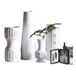 Deco Blanc Vase, Petite - Deco Blanc Vases These ceramic Deco Blanc Vases pair vintage accent shapes with a clean white polish. The result is Deco Blanc Vase that have an energised appeal that brings a spark of interest into unexpected nooks and ledges.