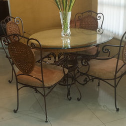 * Upholstery and Reupholstery work - Stained metal chairs and reupholstered cushions