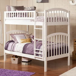 Atlantic Furniture - Atlantic Furniture Richland Twin over Twin Bunk Bed - AB64102 - Shop for Bunk Beds from Hayneedle.com! Space efficiency and multitasking come together to create the Atlantic Furniture Richland Twin over Twin Bunk Bed. This charming bunk bed features two twin size beds with a safety guardrail on the top bunk. Composed of eco-friendly hardwood solids the bed set includes a ladder as well as a hardwood slat kit with reinforced steel panels for added durability. This bed is available with storage drawers underneath the bottom twin bed an optional trundle for storage or extra sleeping space. For the ultimate bunk bed it's available as a configuration that includes the bed and either the trundle or storage drawers or as the bed only. Simply choose a finish color to complement any bedroom setting. Dimensions: Twin bed: 78.13L x 41.38W x 30.75H in. Storage drawer: 37.25W x 21D x 12H in. Trundle: 74.75L x 39.25D x 11.63H in. About Atlantic FurnitureFounded in 1983 as Watercraft Inc. Atlantic Furniture started as a manufacturer of pine waterbed frames. Since then the Springfield Mass.-based company has expanded to Fontana Calif. The company has moved away from the use of pine and now specializes in imported furniture made of the wood of rubber trees. The Benefits of Eco-Friendly RubberwoodPrized as an environmentally friendly wood rubberwood makes use of trees that have been cut down at the end of their latex-producing life cycle. The trees are removed by hand and replaced with new seedlings. In the past felled rubber trees were either burned on the spot or used as fuel for locomotive engines brick firing or latex curing. Now the wood is used in the manufacture of high-end furniture. It is valued for its dense grain stability attractive color and acceptance of different finishes. Atlantic's Unique Five-Step Finishing ProcessEach product in the entire line is finished with a high-build five-step finishing process. After a thorough sanding a wipe-on sealer 