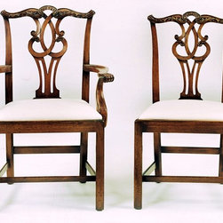 """Wright Table Company - The No. 152 Chippendale Arm Chair & No. 151 Chippendale Side Chair - We bought two side chairs at Sotheby's, N.Y., made them larger and invented a matching arm chair. This is the best looking chippendale chair of its type that we have seen. We have no idea who designed it, but it is English ca. 1760. Virtually all the joints are flush, the stretchers are well-placed and stippling is used in the carving on the crest rail. The backposts are wounded and bevelled to lighten their appearance. The back of the chair is just as graceful as the front. Grab the crest rail, it has a wonderful feel to it. The word chair comes from the Greek word  """"kathedra."""" A cathedral is where the bishop keeps his chair."""