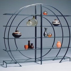 "Johnston Casuals - Eclipse Contemporary tagre - Have you always wanted a stylish yet functional way to display your favorite treasures? The Eclipse Contemporary tagre, featuring a visually stimulating contemporary design, is sure to exceed your expectations. With its glass shelves and many available metal finishes, this contemporary tagre is versatile enough to match any dcor. Individually hand-made in Johnston Casuals' USA factory, you can be sure this tagre will provide years of lasting quality and aesthetic appeal. tagre Features: -Shown in ""onyx"" finish. -Available in many metal finishes. -Individually hand-crafted in the USA. -High quality powder-coat metal construction. -Glass shelves. -Visually stimulating contemporary design. -Overall dimensions (each side): 79"" H x 46"" W x 20"" D. -Overall dimensions (together): 79"" H x 92"" W x 20"" D. -10-Year structural failure warranty on metal frame. -Please Note: This item is constructed with a method called ""Bubble-Gum Welding"" which may cause the joints or welds to appear rough, lumpy or unfinished. This is *not* a defect but is done to create a stronger weld. More customization options may be available for an additional charge. Also, please be aware that as each item is created individually, slight variations in finish and shape may occur."