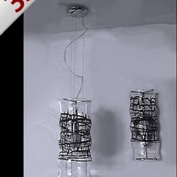 "Studio Italia Design - Studio Italia Design Graffiti pendant light large-black Inventory sale! - The Graffiti pendant light-large-black is an in-house design by Studio Italia Design. This adjustable luminaire comes with a chrome frame and a crystal clear diffuser with details in hand-blow milk white glass or black glass. There are two sizes available. This fixture is a crowd-pleasing, artistic statement that refuses to be overlooked. UL Listed.  Only one piece left at this exceptional price!  Product Details:   The Graffiti pendant light-large-black is an in-house design by Studio Italia Design. This adjustable luminaire comes with a chrome frame and a crystal clear diffuser with details in hand-blow milk white glass or black glass. There are two sizes available. This fixture is a crowd-pleasing, artistic statement that refuses to be overlooked. UL Listed.  Only one piece left at this exceptional price!  Details:     Manufacturer:   Studio Italia Design     Designer:  Studio Italia Design     Made in:  Italy     Dimensions:   Height: 20.08"" (51 cm) X Width: 8.66"" (22 cm)     Light bulb:   1 X 150W Incandescent      Material:   metal,glass"