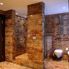 Rustic Bathroom by Infinity Barns and barndominiums