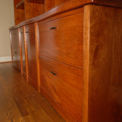 """Library Bookcase - Solid Cherry Library Bookcase. Massive 8'x8'x2' custom designed & hand built piece. This piece is classic & modern at the same time. The Appalachian Cherry is natural color with a very fine hand-rubbed Tung Oil & Varnish finish that is satiny to the touch & to the eye. Components are up-sized: Shelves are 1"""" thick. Other framing components are 1.75"""" thick. Joinery is mortise-tenon & dovetail."""