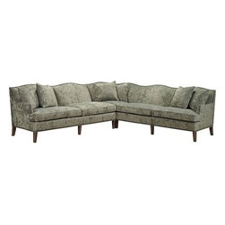 Hickory Chair Sectionals - Shown as a Pablo Sectional. This piece was originally made as a unique corner settee to be placed in front of a window. The shape is distinctive, with a gracious, undulating camel-back and fine upholstery details including full nailhead trim. The primary form of Pablo is called a settee, but it really has the comfort, generous form and sitting depth of a sofa, as well as the corner functionality of a sectional. Even as it sits and is scaled like a sofa, it is raised on clean, tapered wood legs almost more like a banquette, and therefore appears very light and new in profile, especially for the sectional customer. The settee has been meticulously proportioned and engineered in two pieces for both right- and left-facing configurations. This makes the resulting corner piece more integral and finely framed than a modular, mix-and-match sectional form of upholstery. As companions for different seating needs, we have also adapted the armrest and the length of the main form as a sofa and loveseat.