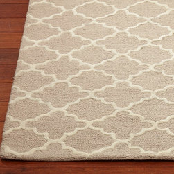 Addison Rug, Khaki - Sometimes a neutral color can work wonders in a space full of children's toys and books. This soft tan and antique white trellis print would help to ground a busy playspace.