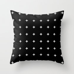 White Cross on Black Throw Pillow by Pencil Me In - I like pillows that are bold and add some fun to a room. This one has serious style.