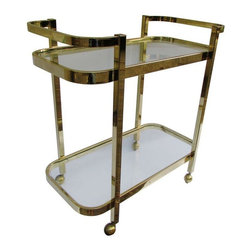 Used Pristine Brass Bar Cart by Milo Baughman - Classic, sleek, and striking. This brass bar cart by Milo Baughman will be the highlight of your holiday parties!! It is heavy and sturdy with solid welded construction. Impeccable quality and craftsmanship!    The brass tone on the cart is deep and beautiful. The brass and glass are both in phenomenal, above average, vintage condition. This item has seen very little use if any. All casters are in very good condition and roll smoothly. It is showroom ready!