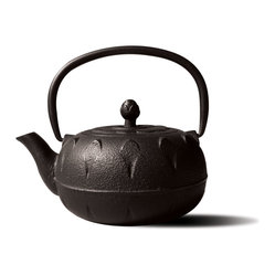 "Old Dutch International - Matte Black Cast Iron ""Chubu"" Teapot, 18 Ounce - Let your tea simmer in style in this charming cast iron tetsubin. The Japanese-inspired cast iron kettle features beautiful curved lines and lotus flower design. Remember, don't use on the stove — it's only built to keep your tea warm and tasty on the table."