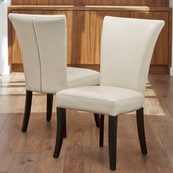 Best Selling Home Decor - Stanford Ivory Leather Dining Chairs - 2 Pack Ivory White - 217179 - Shop for Dining Chairs from Hayneedle.com! Add a touch of contemporary style to your dining set with the Stanford Ivory Leather Dining Chairs - 2 Pack. These chairs have a classic Parson design wrapped in an ultra modern white bonded leather upholstery. The wooden frame is finished in black for great contrast. You get two chairs in the set.About Best Selling Home Decor Furniture LLCBest Selling Home Decor Furniture LLC is a US-based company dedicated to providing you with a wide variety of fine furniture. With sales and manufacturing offices in Europe and China as well as the ability to ship to anywhere in the world no one is excluded from bringing these lovely pieces home. From outdoor to indoor furniture children's furniture to ottomans and home accessories all your needs will be met with attractive high quality products that will last.