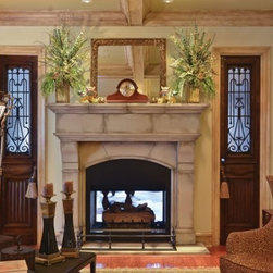 Living room - Our antique iron French doors grace either side of the fireplace in this lovely Southern home.