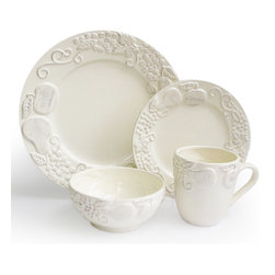 Jay Import Co - Frutta 16-Piece Dinnerware Set, Cream - Talk about a fruit plate! A charming relief of apples, pears and grapes adorn these dishes (16 pieces, a full service for four) to bring unique charm to your table. Now, if you could only get your crew to eat their vegetables!
