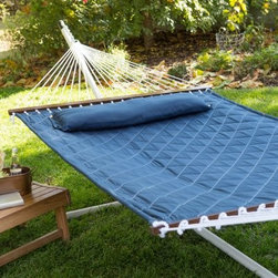 Island Bay 13 ft. Diamond Stitch Quilted Hammock - Navy - It's like swaying in the sky! You'll love the Island Bay 13 ft. Diamond Stitch Quilted Hammock – Navy. The quilted fabric in blue makes the bright white quilt stitching really pop! Made of durable poly fabric this hammock features a quilted design wood spreader bars and durable hanging rope. It's big enough for 2 if you feel like sharing. Also included is a comfy pillow to make sure you get absolutely nothing accomplished. Note that the stand isn't included - we recommend this one to pair with it beautifully. About Island Bay HammocksIsland Bay brings you well-designed authentic hammocks and accessories from around the world. From the East Coast to the West Indies the hammock is recognized as the ultimate getaway so we've dedicated ourselves to getting it right. You'll find eye-catching colors and patterns comfortable outdoor designs and heavy-duty stands designed to keep you swinging peacefully. It's your world ... relax in the real thing.