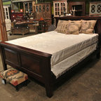 Customers Homes - This photograph was taken in the Discoveries Hammond Warehouse store.  Shown here is our Hudson rosewood bed that we have made in India. You can also see many of our other furniture & finds that we travel the world to hand select along with developing our own exclusive designs.